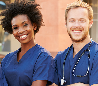 An African-American female therapist and a Caucasian male doctor with stethoscope