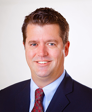 headshot of Dr James A Bynum MD