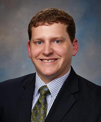 Headshot of Dr David Eichten