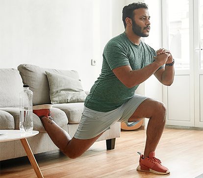 Young Middle Eastern man works out at home to avoid a hip and knee replacement