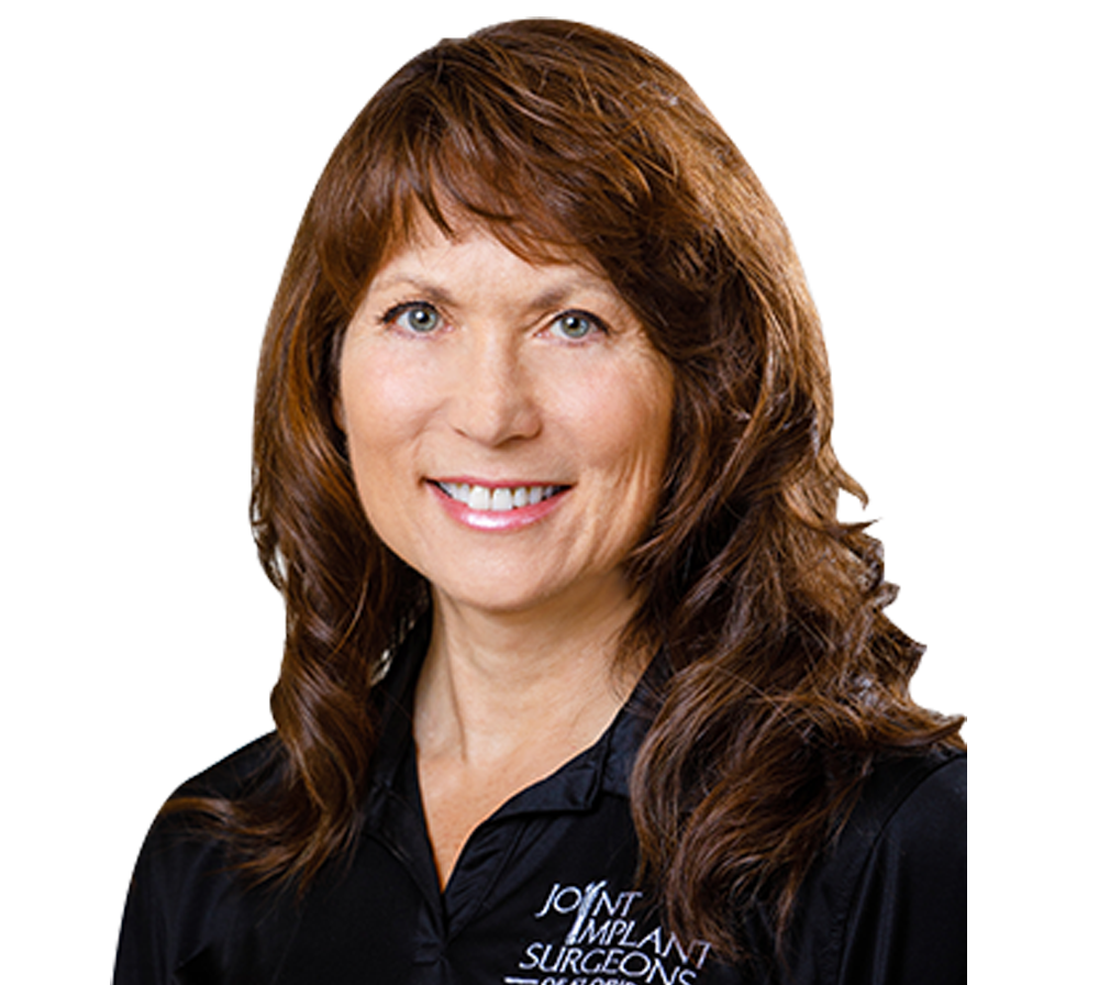 Headshot of Occupational Therapist Constance Kurash in black polo shirt smiling at camera on transparent background