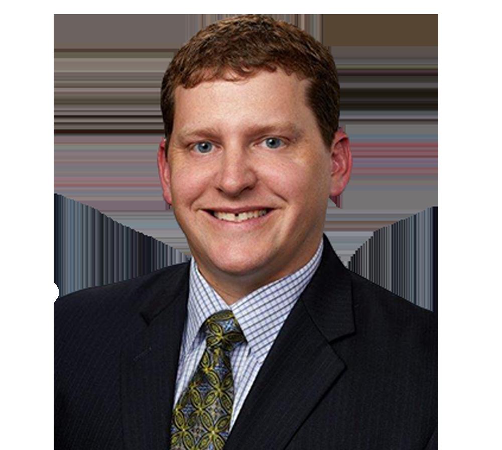 Headshot of Physician Dr David Eichten smiling at camera on transparent background