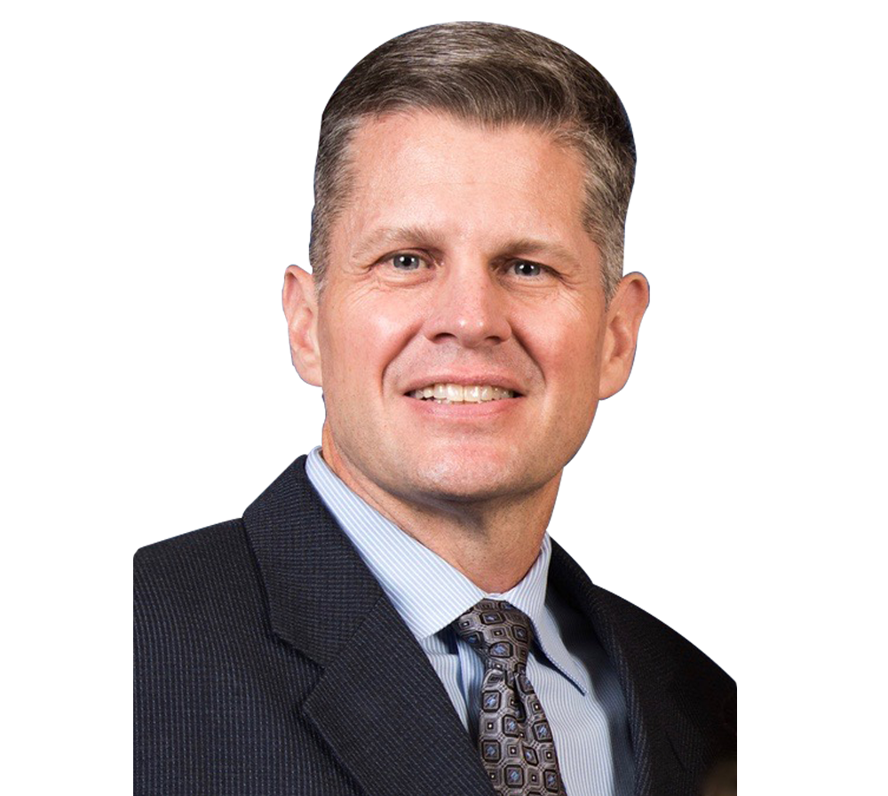 Headshot of Physician Dr Jeffrey Henn smiling at camera on transparent background