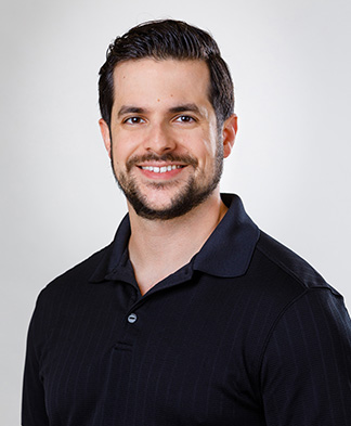 Headshot of Physical Therapist Christian Palermo smiling at camera on transparent background