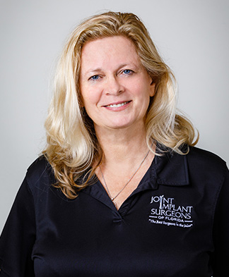 Headshot of Physical Therapist Janneke Huber smiling at camera on transparent background